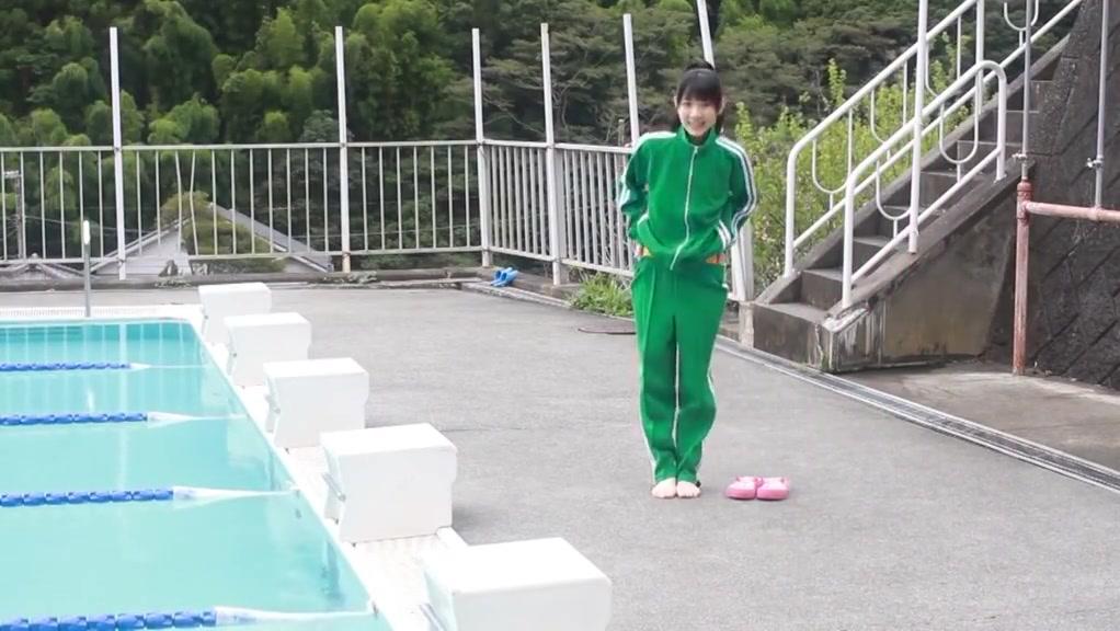 Asian Female Swim In Pool With Yellow Bikini Sensitized